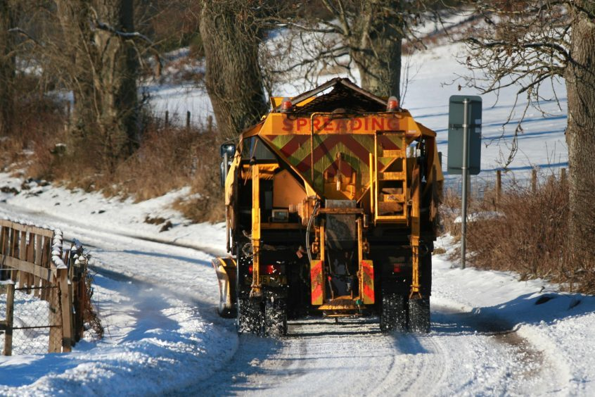 A snow plough working to try and clear the road near Pitcairngreen. 08/01/11.