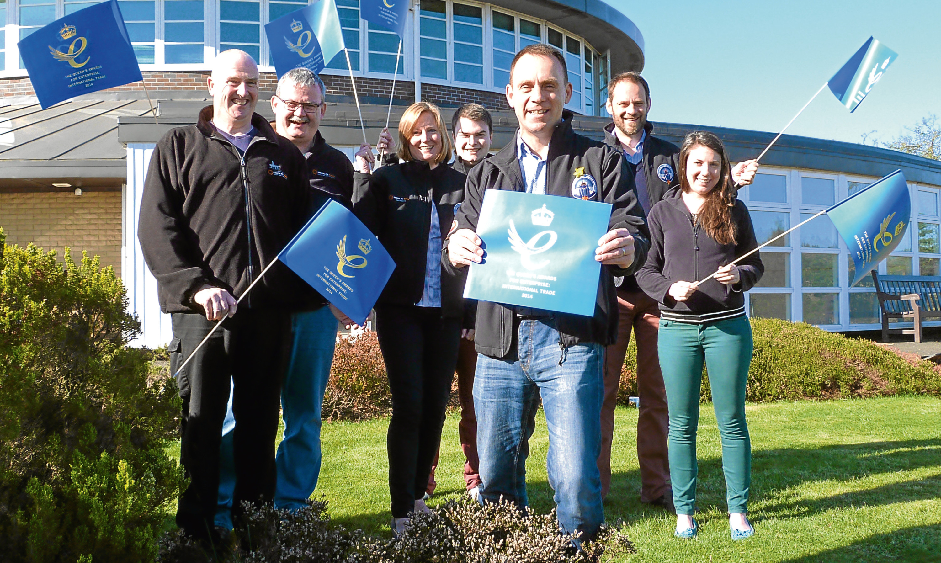 Iain Hutchison and members of the Merlin ERD team celebrate one of two Queen's Award for Enterprise in 2017