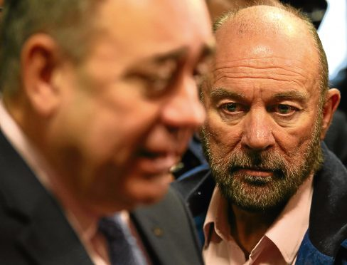 First Minister Alex Salmond is watched by businessman Brian Souter ahead of the independence referendum in 2014.