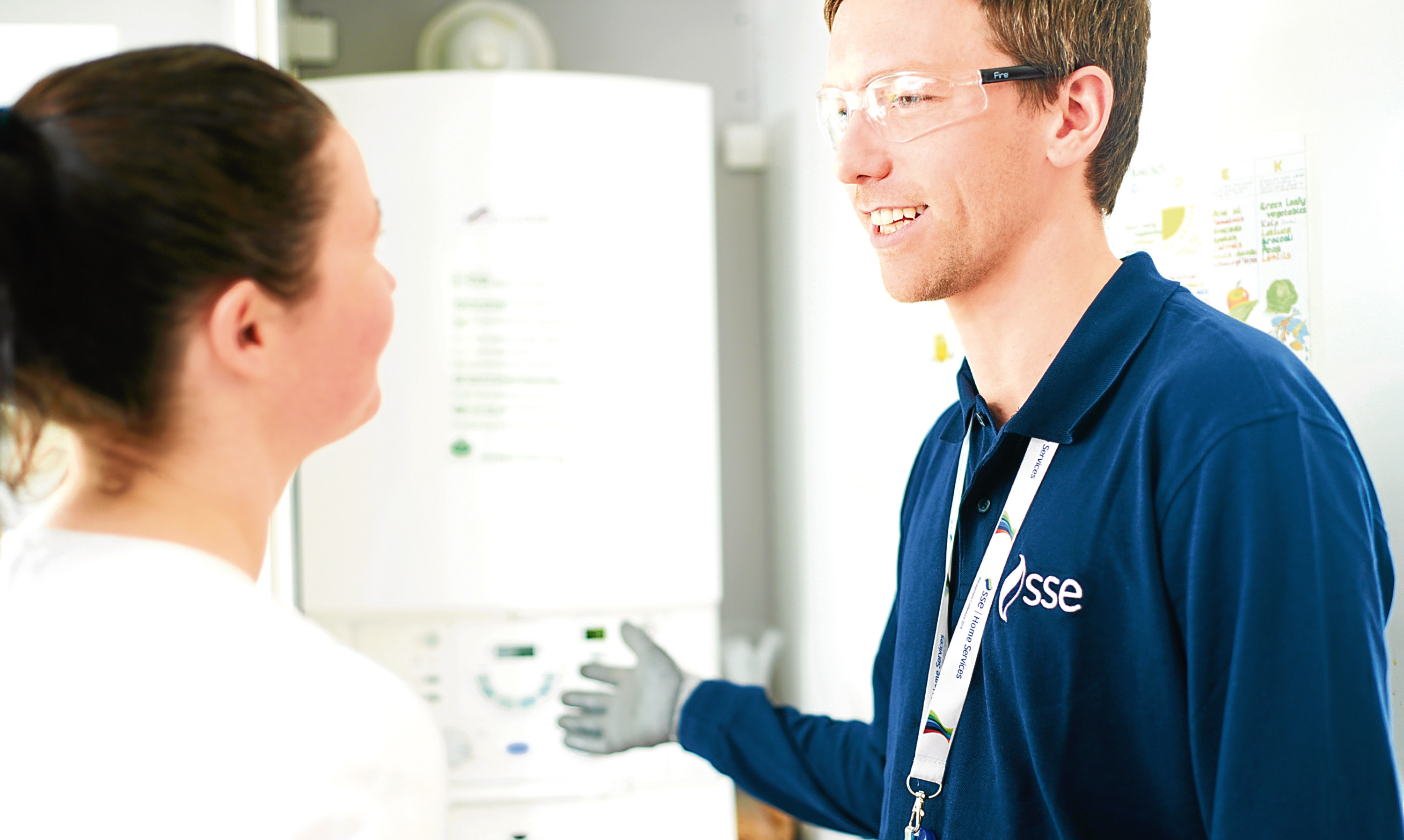 An SSE home engineer talks with a customer