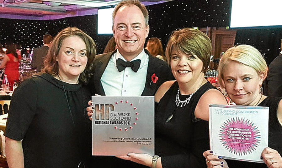Andy Lothian, CEO Insights Learning & Development, celebrates with Susan Duncan, Brenda Douglas and Jan Anderson