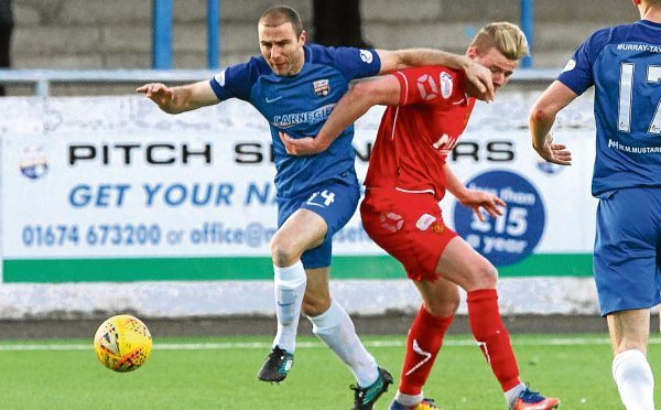Sean Dillon, left, in action for Montrose.