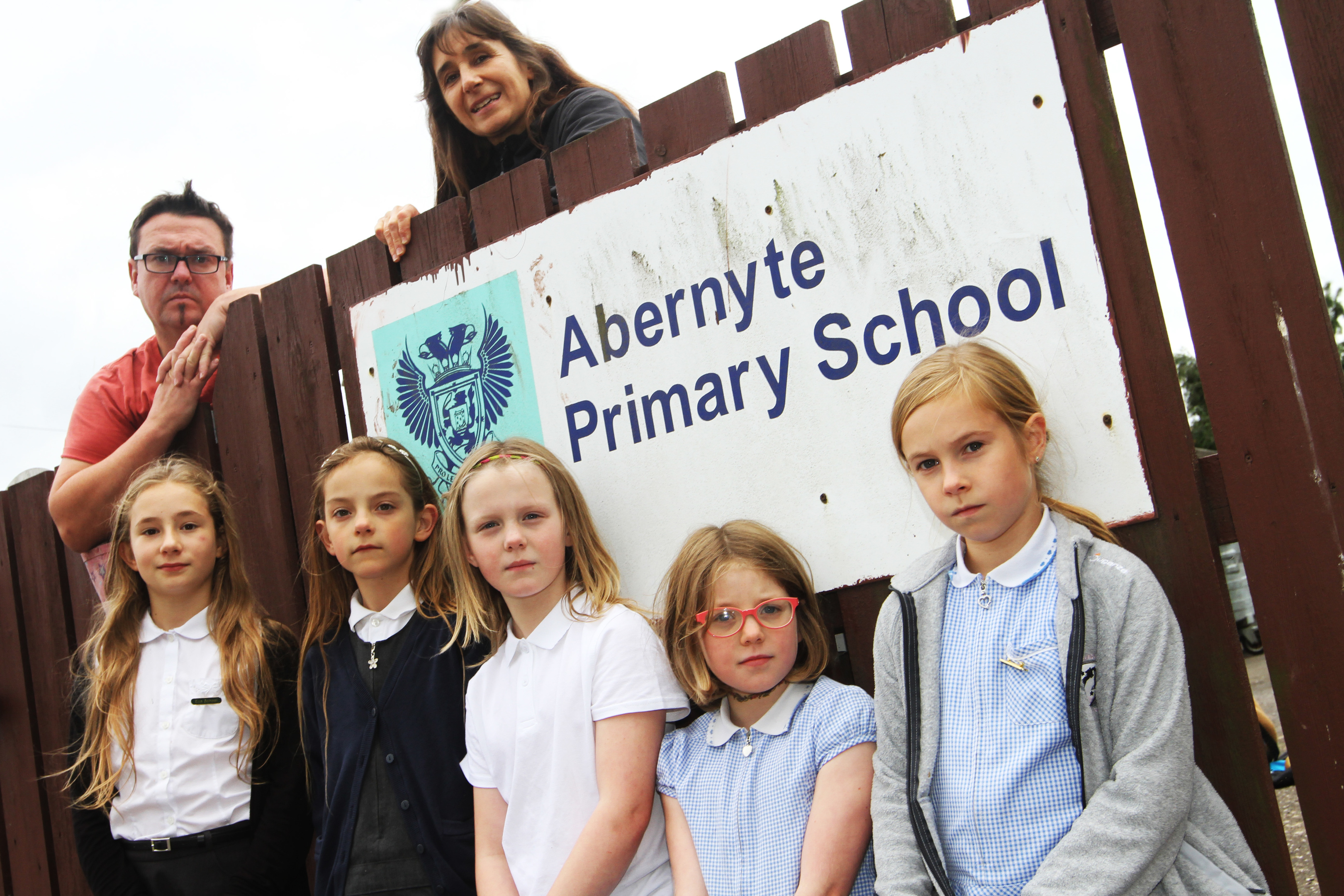 Abernyte Primary School is one of the schools that could close under the council's estates review. Parents think it has been deliberately undermined by the council.  Picture shows; Chairman and Treasurer of the Parents Council Gerard McGoldrick and Claudia Lacoux with front l to r, Elle Lacoux, 10, Lucy MacGregor, 8, Anna McGoldrick, 9, Bea Meldrum, 9, Maya King, 9.