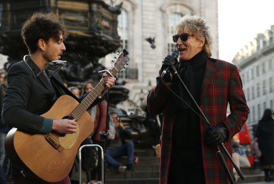 """Star Rod Stewart with singer Henry Facey sing a version of """"Handbags and Gladrags"""