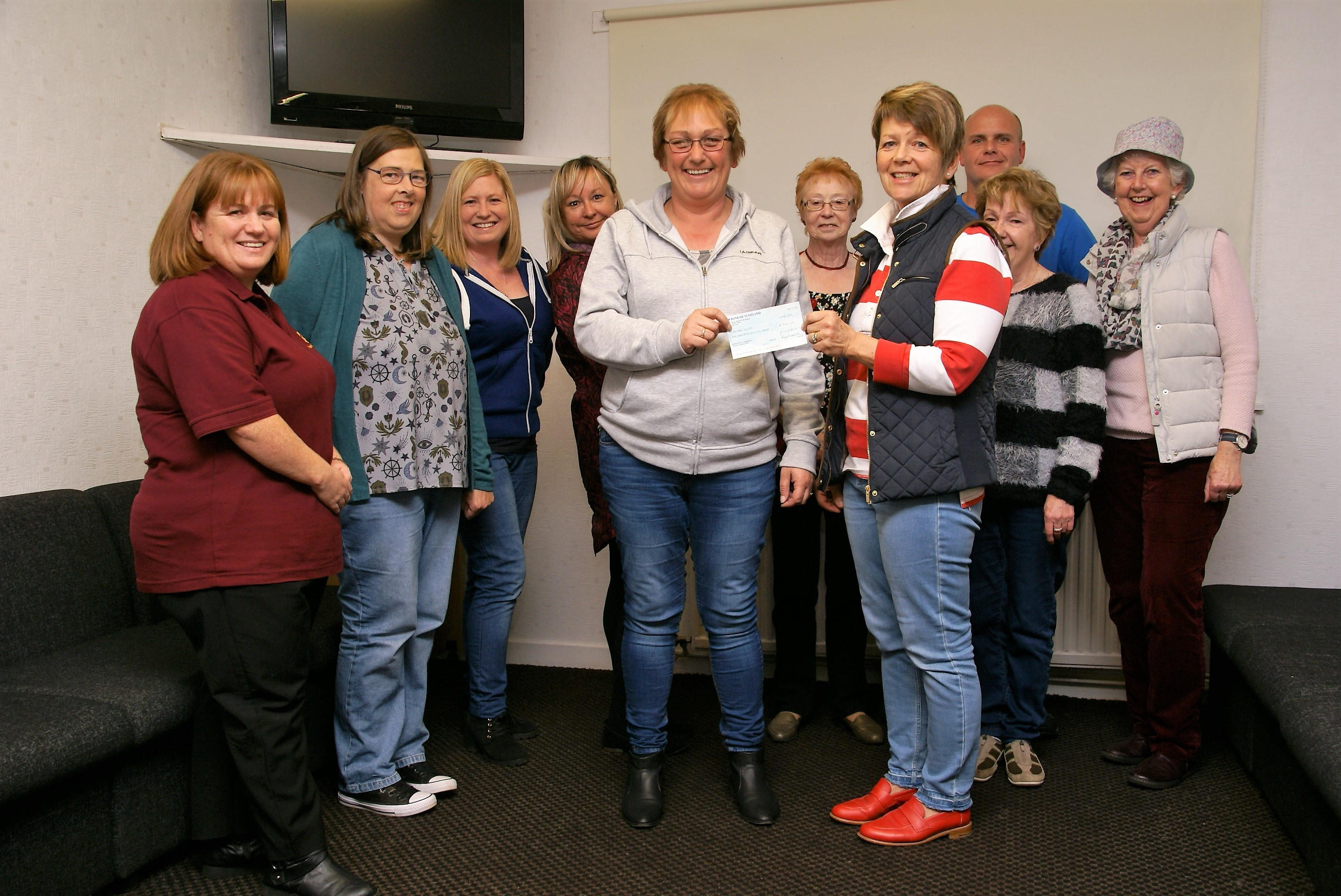 Members of Borrowfield Community Group present their donation to 'Save a Life Montrose'.