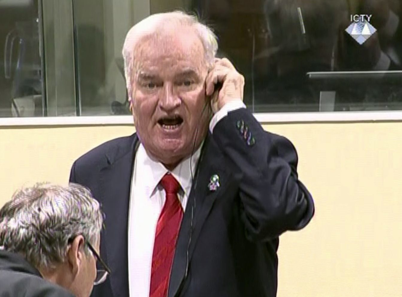 Bosnian Serb military chief Ratko Mladic during an angry outburst in the Yugoslav War Crimes Tribunal in The Hague, Netherlands, on Wednesday