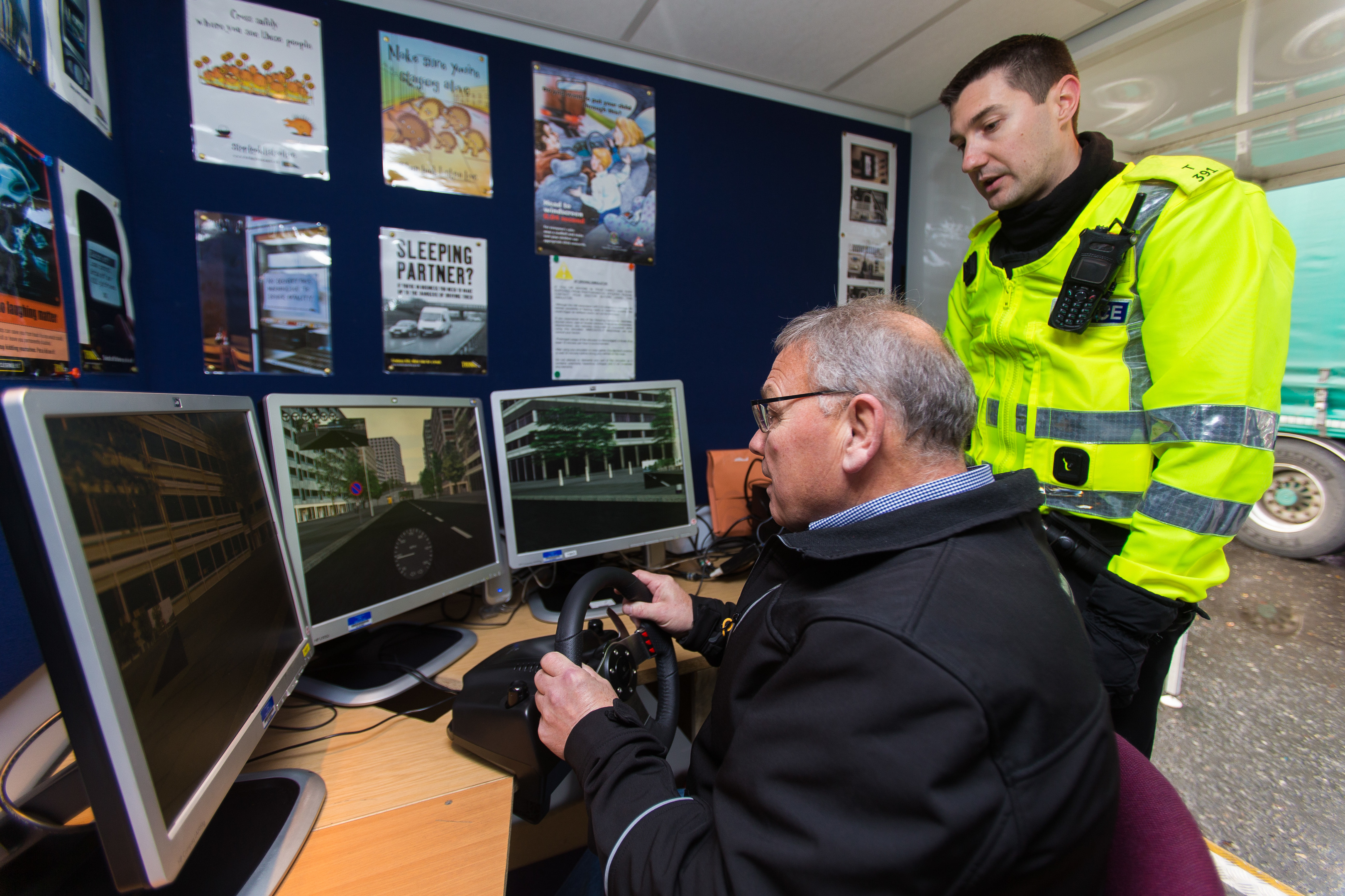 Ian Morrison, 73, is tested by the simulator as PC Craig Amos looks on.