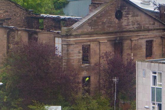 The fire-ravaged church is set to be partly demolished.