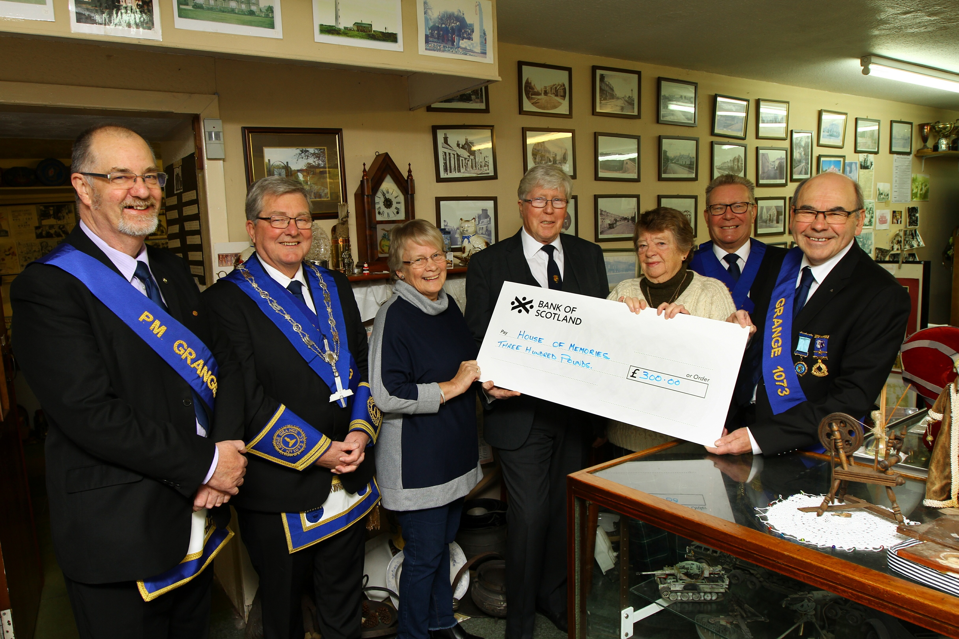 Margaret Copland, 3rd from right, President of the Monifieth Local History Society, and Linda Spalding, 3rd left, Administrator, receiving the cheque for £300 from members of Lodge Grange 1073, L/R, Harry Conway - Past Master, Sam McFadzean - Senior Warden, Bruce Duguid - Past Master, Jim Laing - Immediate Past Master and James Keir - Past Master, at the Monifieth House Of Memories