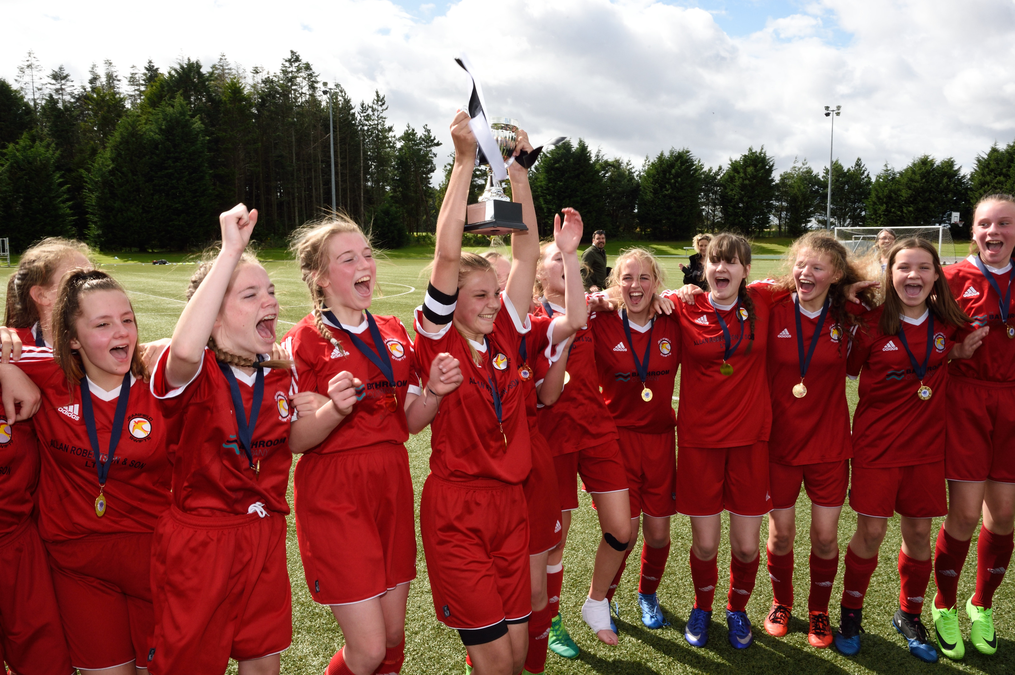 Jeanfield Swifts U15 girls celebrate this year's league cup final win. Photograph: Stuart Cowper.