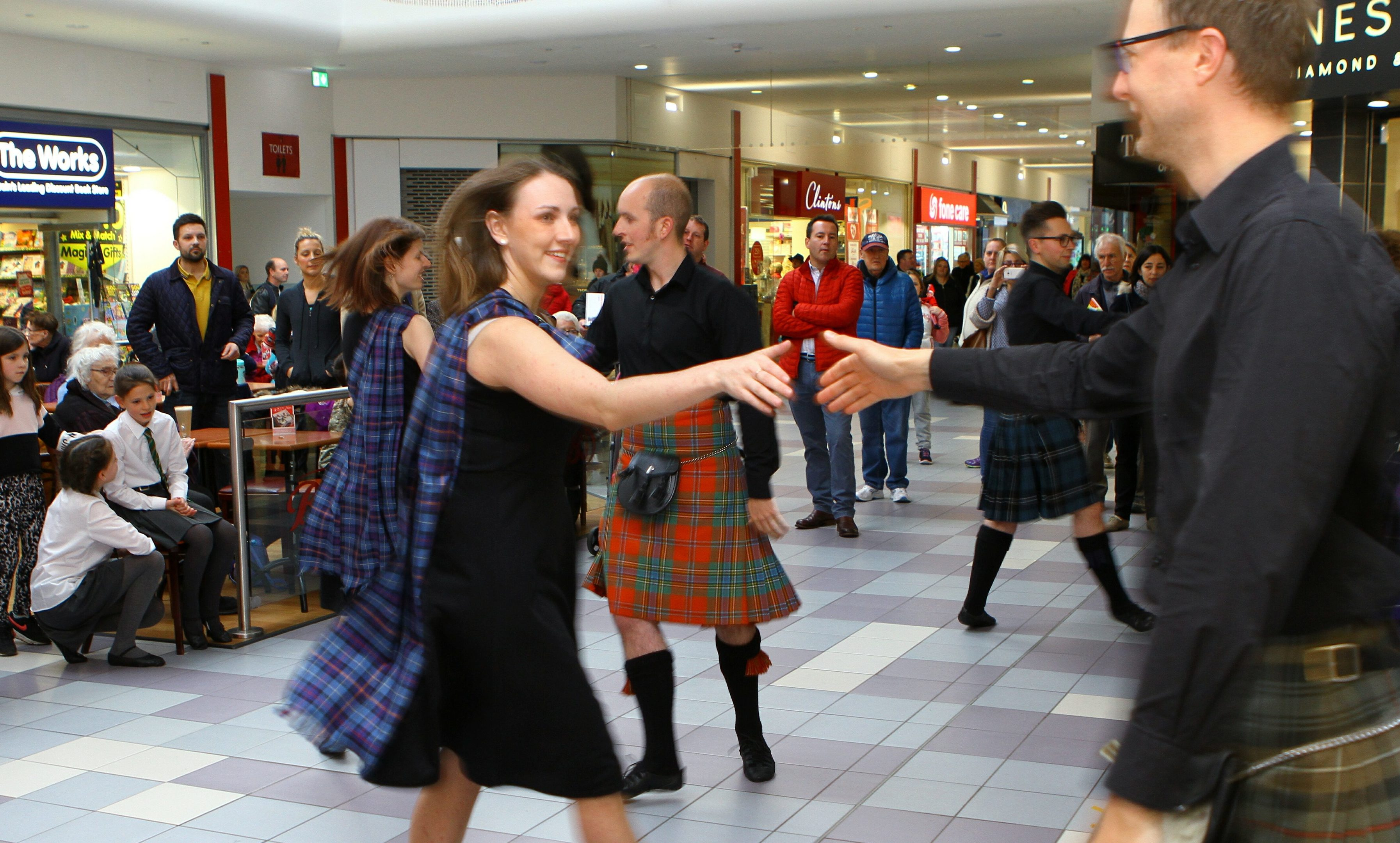 RSCDS members dancing in the busy St. John's Shopping Centre, Perth