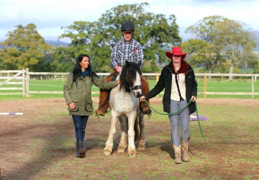 John Byrne, 79. from Rosendael rides Dolly, one of the horses at Saddle Up Ranch, while Gayle and Jessie Probst walk alongside.