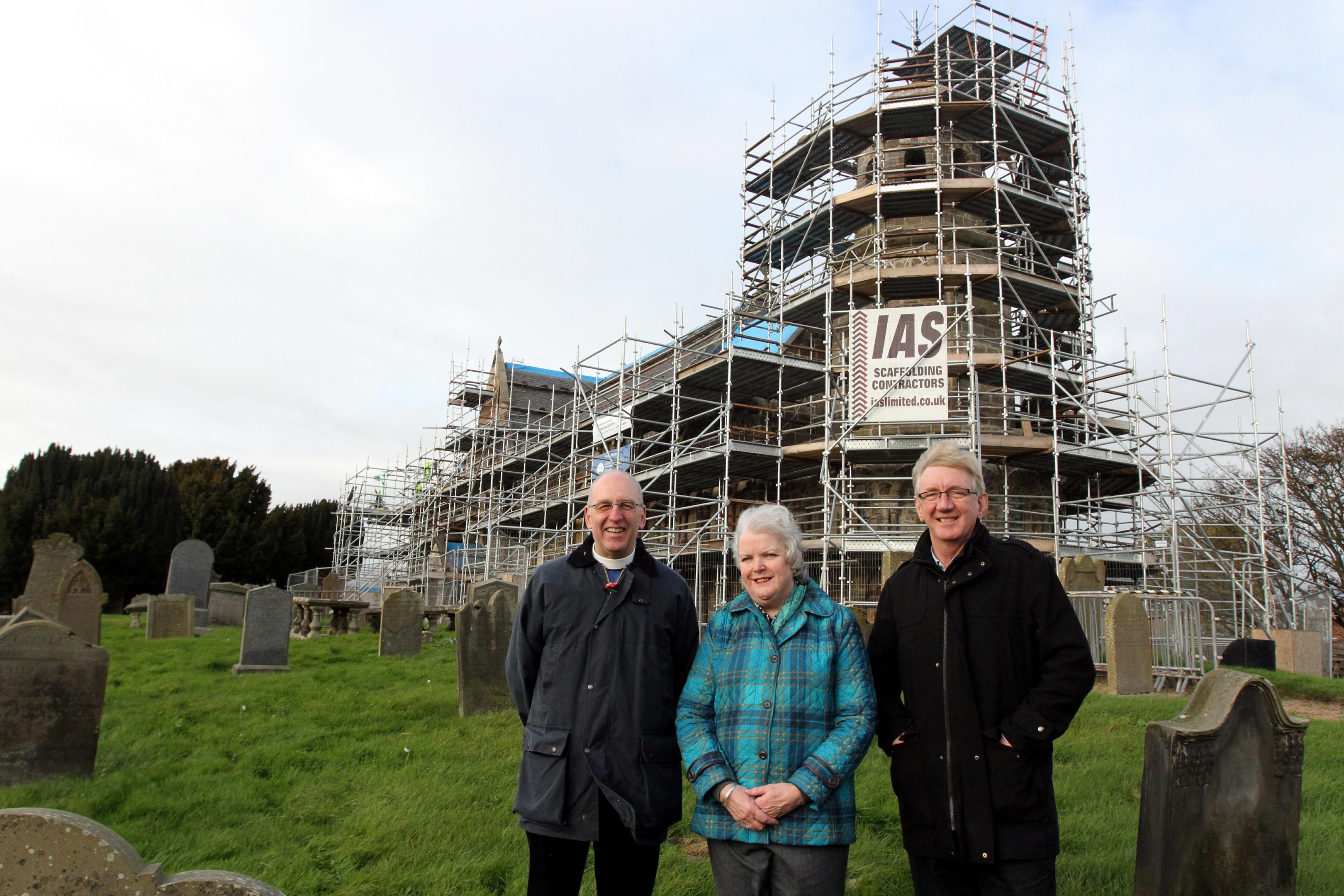 Rev John Duncan, Carol Petrie and Rev John Duncan outside Leuchars St Athernase Church.