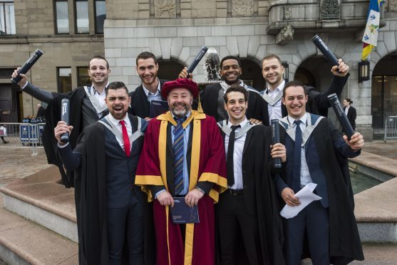 Students celebrate their success with their lecturers.