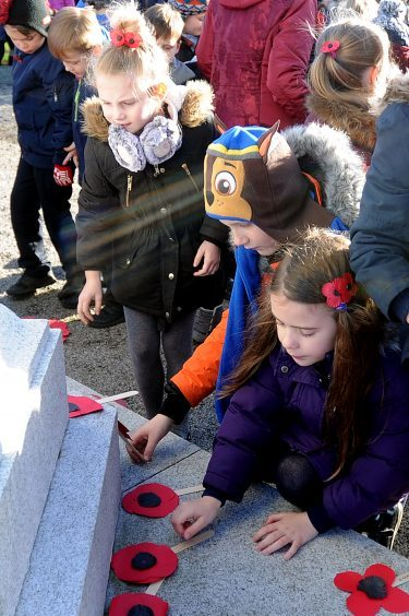 KIRRIEMUIR, ANGUS: All Southmuir and Northmuir primary school pupils were at the war memorial for a two-minute silence and to lay poppies for Remembrance Day.