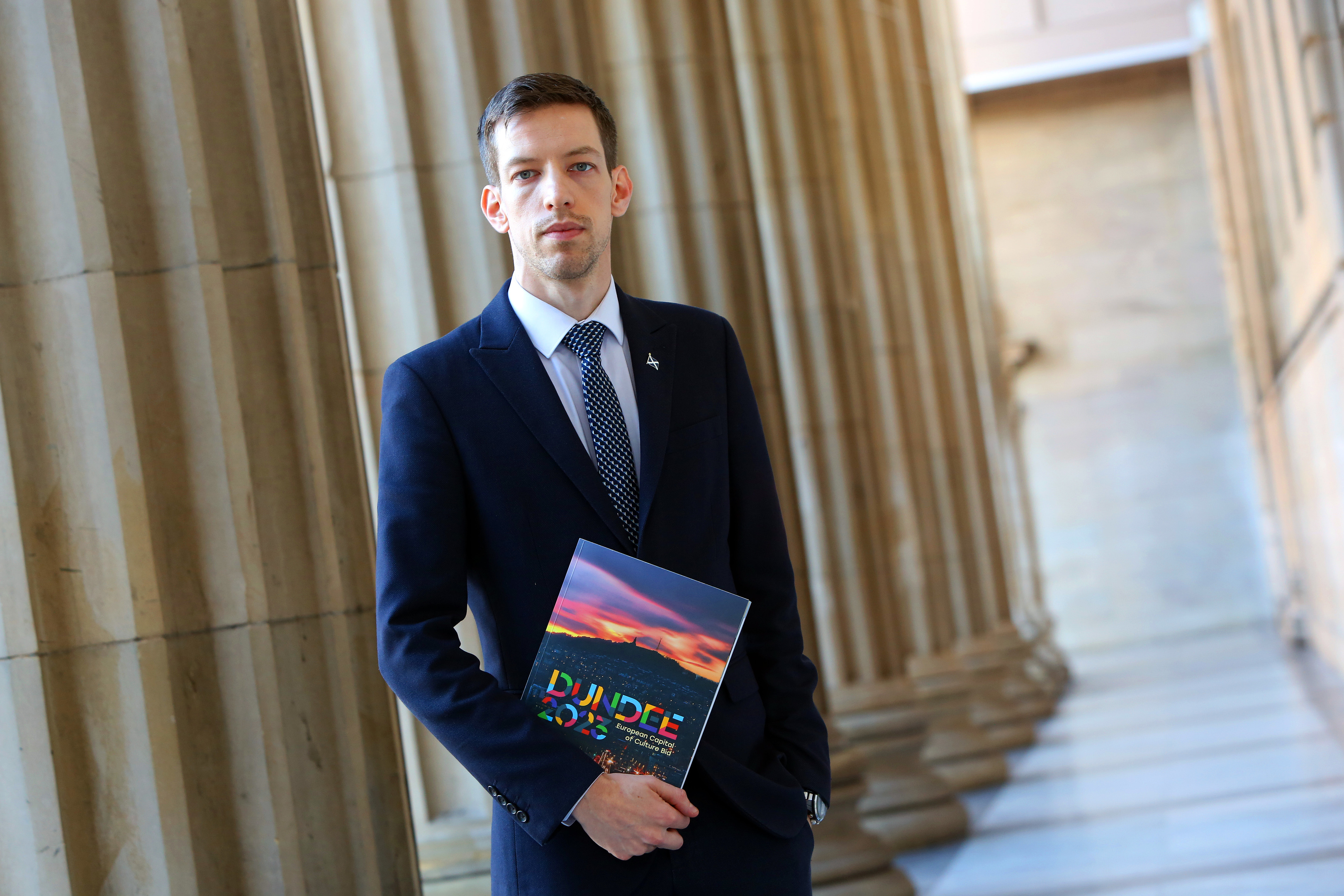 John Alexander, Leader of Dundee City Council with the Dundee 2023 bid brochure.
