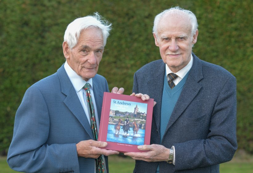 Lorn Macintyre and Peter Adamson show their new book in St Andrews