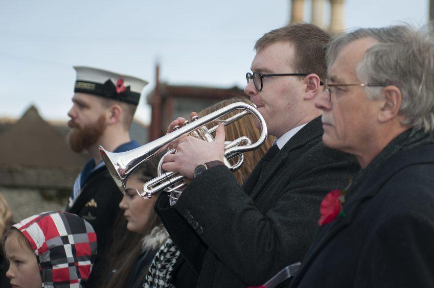 Children lead Johnshaven Community Remembrance event. Picture shows; Scott Ness (Bugle),=