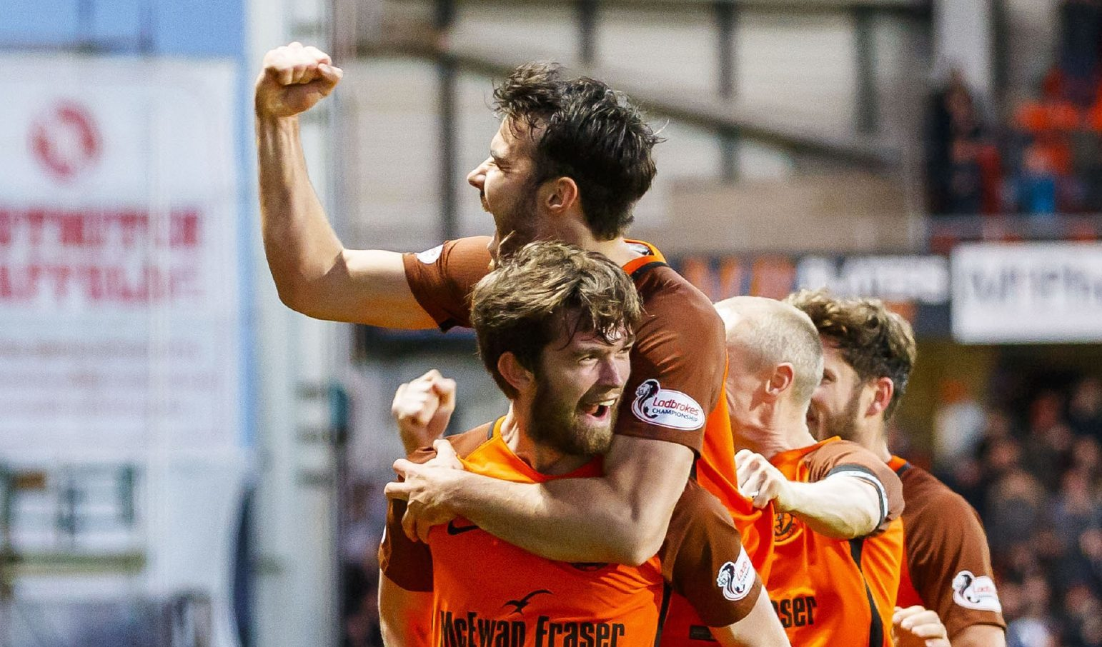Scott Fraser congratulates Sam Stanton after his goal.