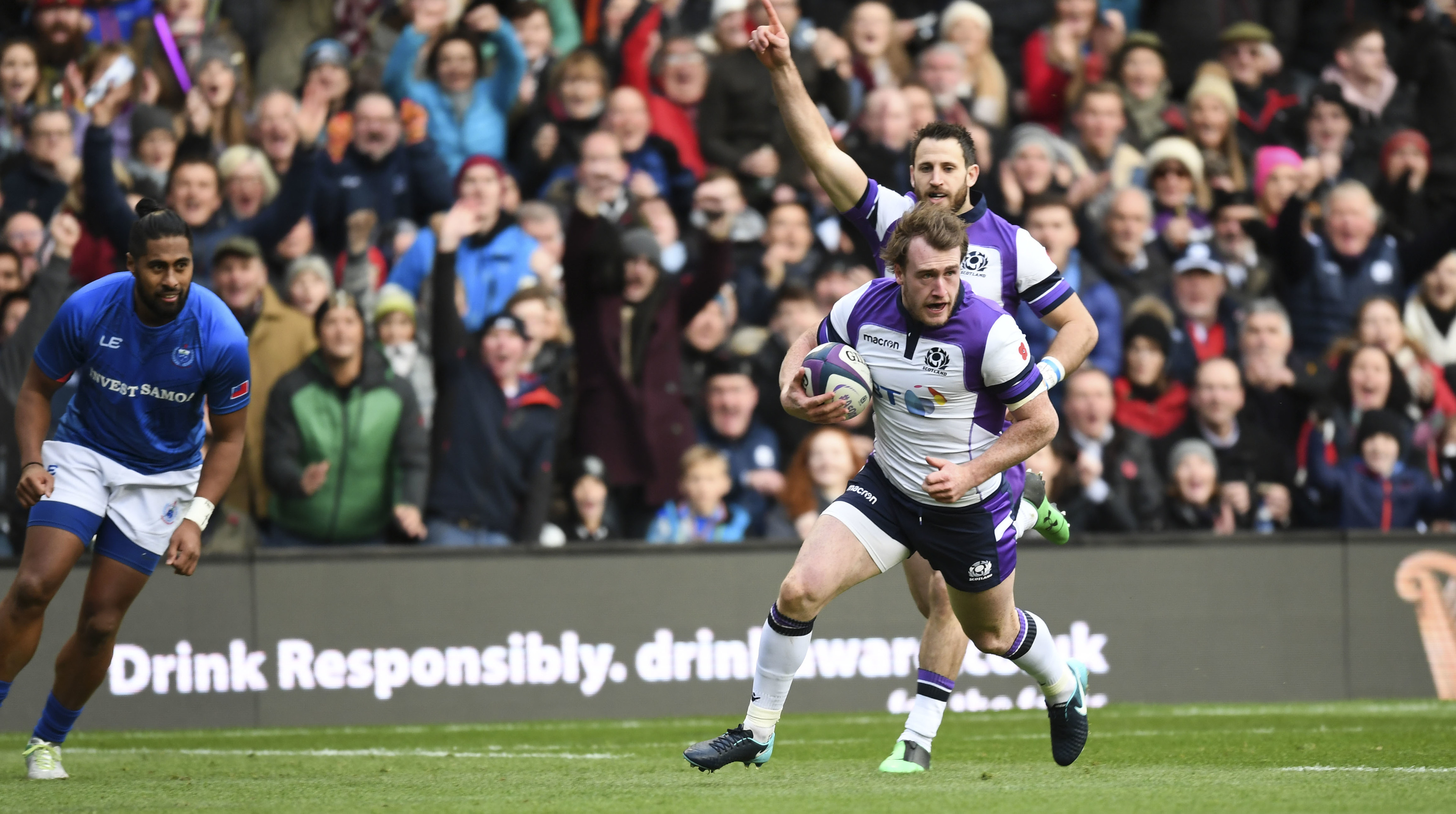Stuart Hogg runs clear to score the opening try at Murrayfield on Saturday.
