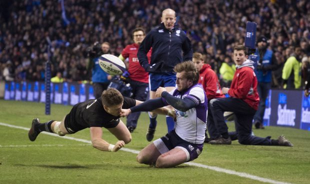 Stuart Hogg just can't get his pass inside to Byron McGuigan in the thrilling finale to Saturday's Autumn Test against New Zealand.