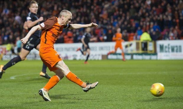 Willo Flood scores the third goal against Falkirk.
