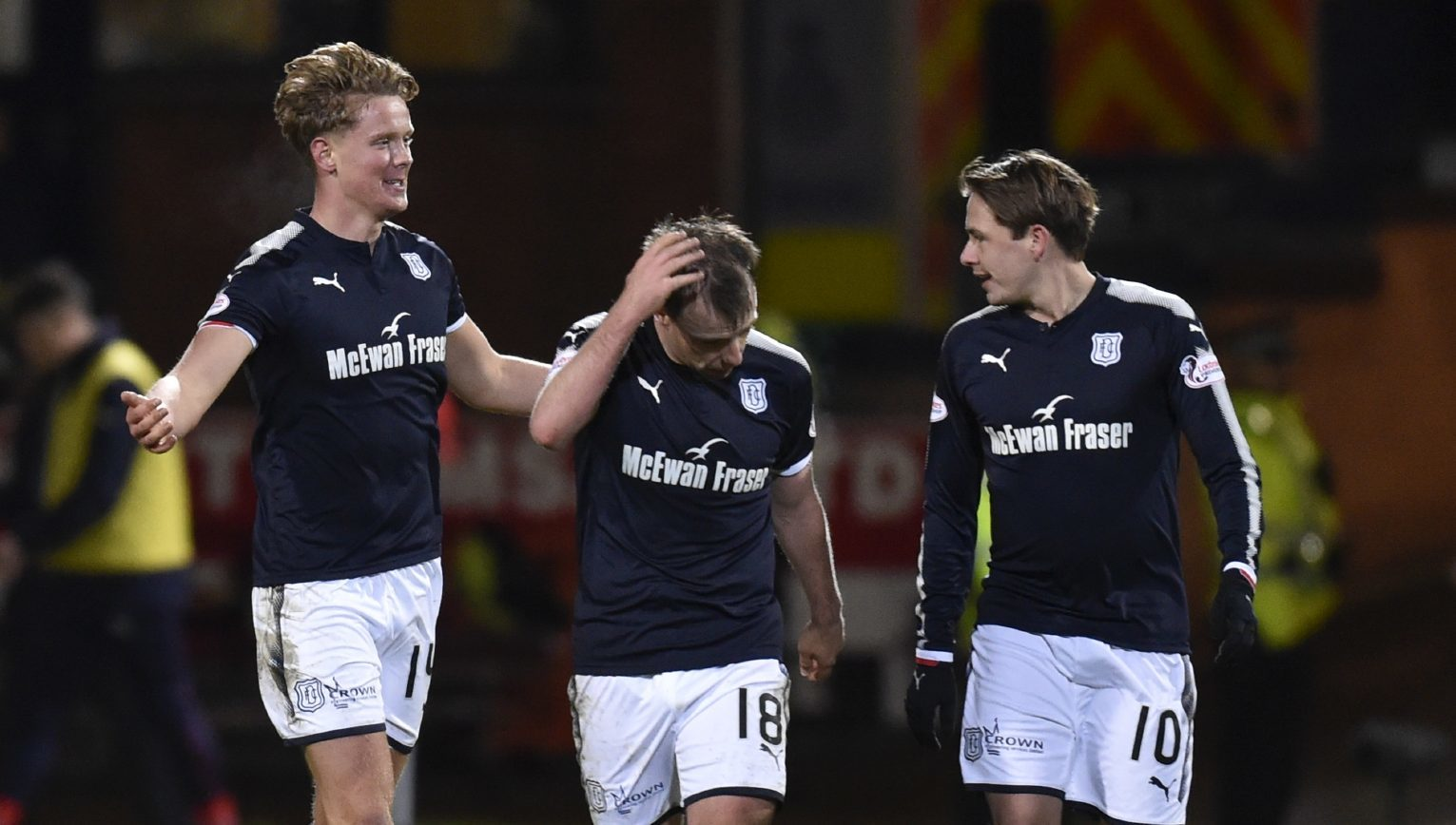 Scott Allan (right) celebrates with scorer Mark O'Hara and Paul McGowan after the second goal.