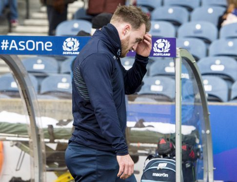 Stuart Hogg leaves the pitch after injuring himself in the warm-up prior to Saturday's win over Australia.