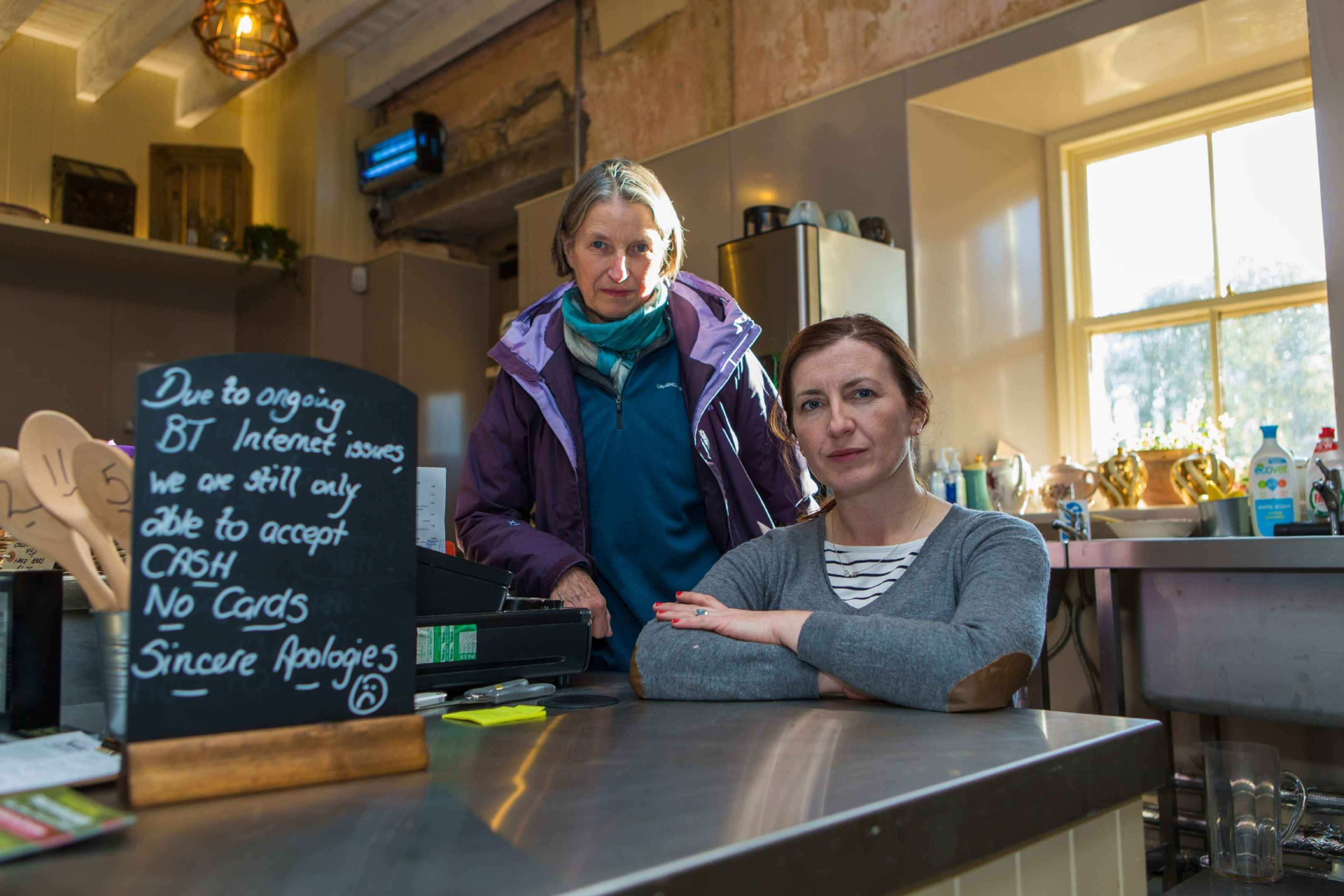 Lady Catherine Erskine and Nosebag Owner Liz Mitchell, disappointed that cash is the only tender they can accept due to BT delays.
