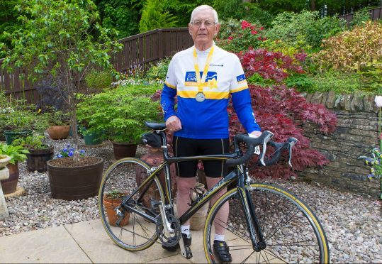 John McNally with his medal from the 2017 Etape Caledonia.