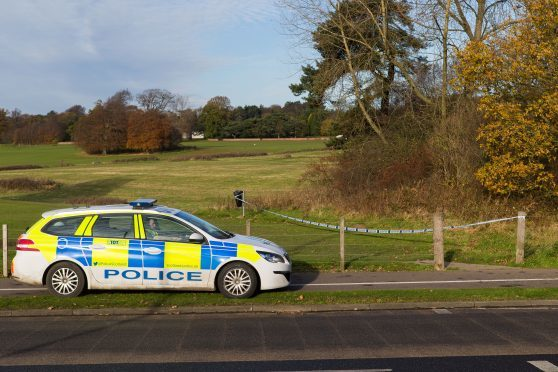 Police posted outside an area of Dunnikier Park with section of woodland taped off.