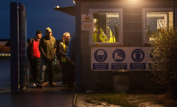 Workers leaving BiFab in Methil on Monday evening.