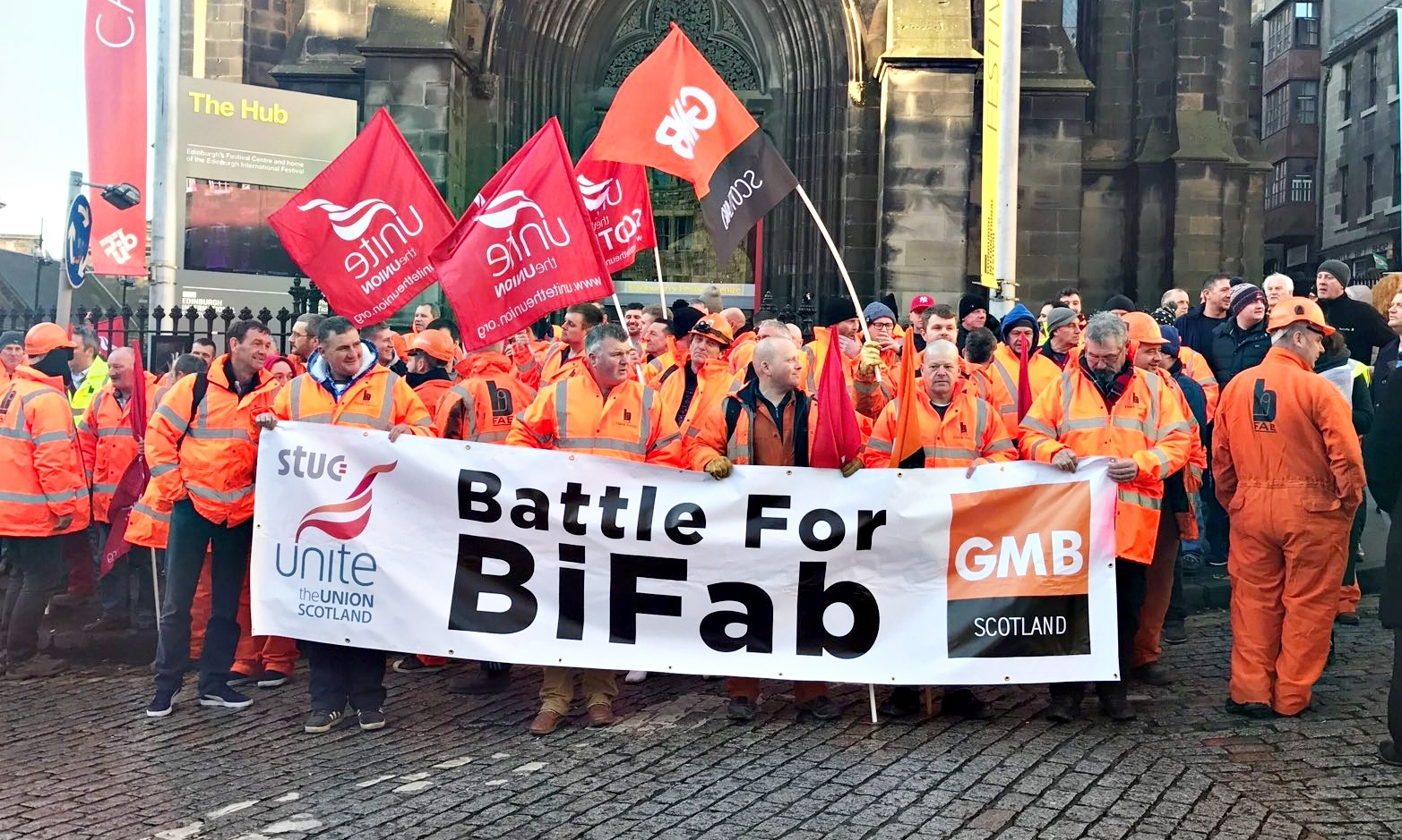 The workers assemble ahead of the march to the Scottish Parliament.