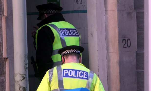 Police investigating a double murder in Dundee in December 2016.