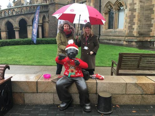 Kim Galligan and Cheryl McDermid, from Mcmanus's learning and engagement team, with the festively-dressed Oor Wullie,