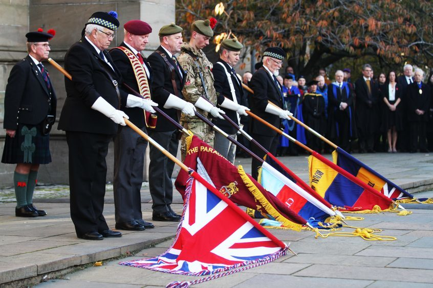Flags were held from various associations across Dundee.