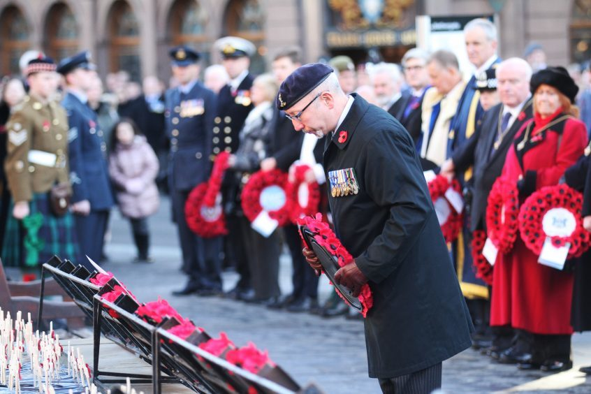 A wreath is laid in Dundee.
