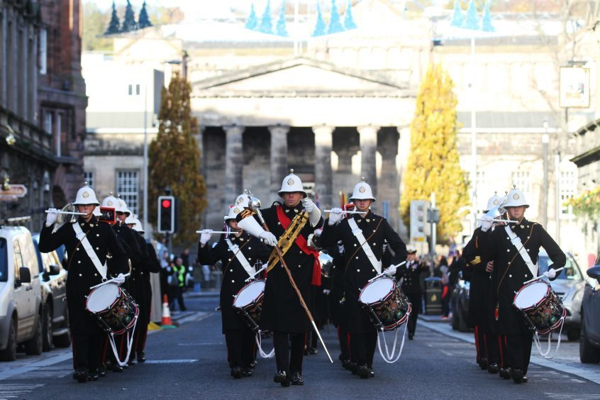 The pipe band led the procession through Dundee's City Centre.