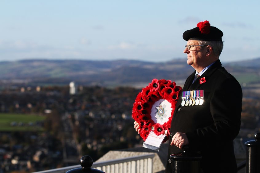 Major Colin Gray, President of the Dundee branch of the Black Watch Association waiting at the top of the Law for the wreath laying ceremony to begin.