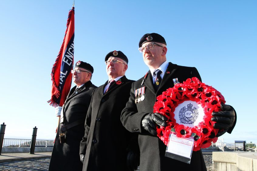 Members of the Royal William Engineers Association Dundee, Standard Bearer William Dunn, Secretary Mick Harness and Chairman George Simpson at the top of the Law Hill.