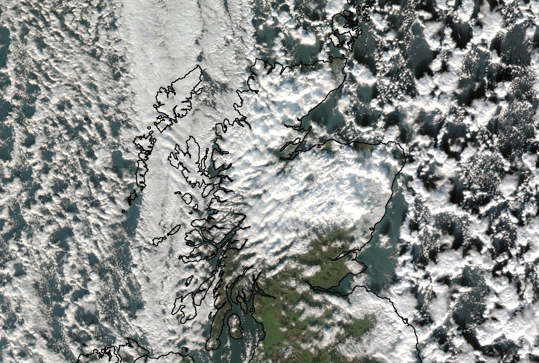 A satellite image showing snowy and cloudy scenes across Scotland.