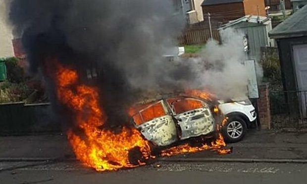 The car at the height of the blaze.