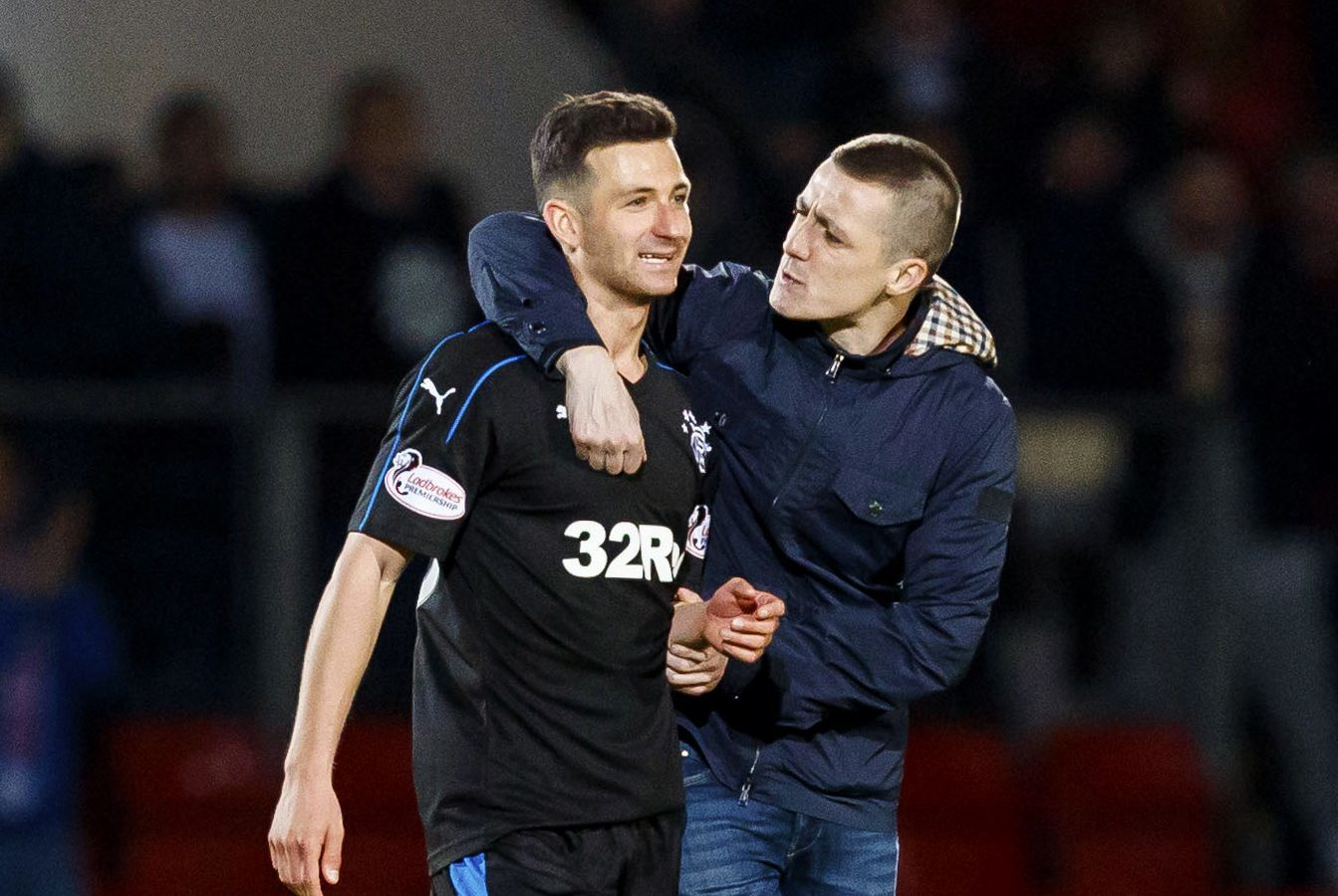 Redmond with Rangers player Jason Holt during his pitch invasion