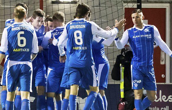 Saints celebrate the winning goal.