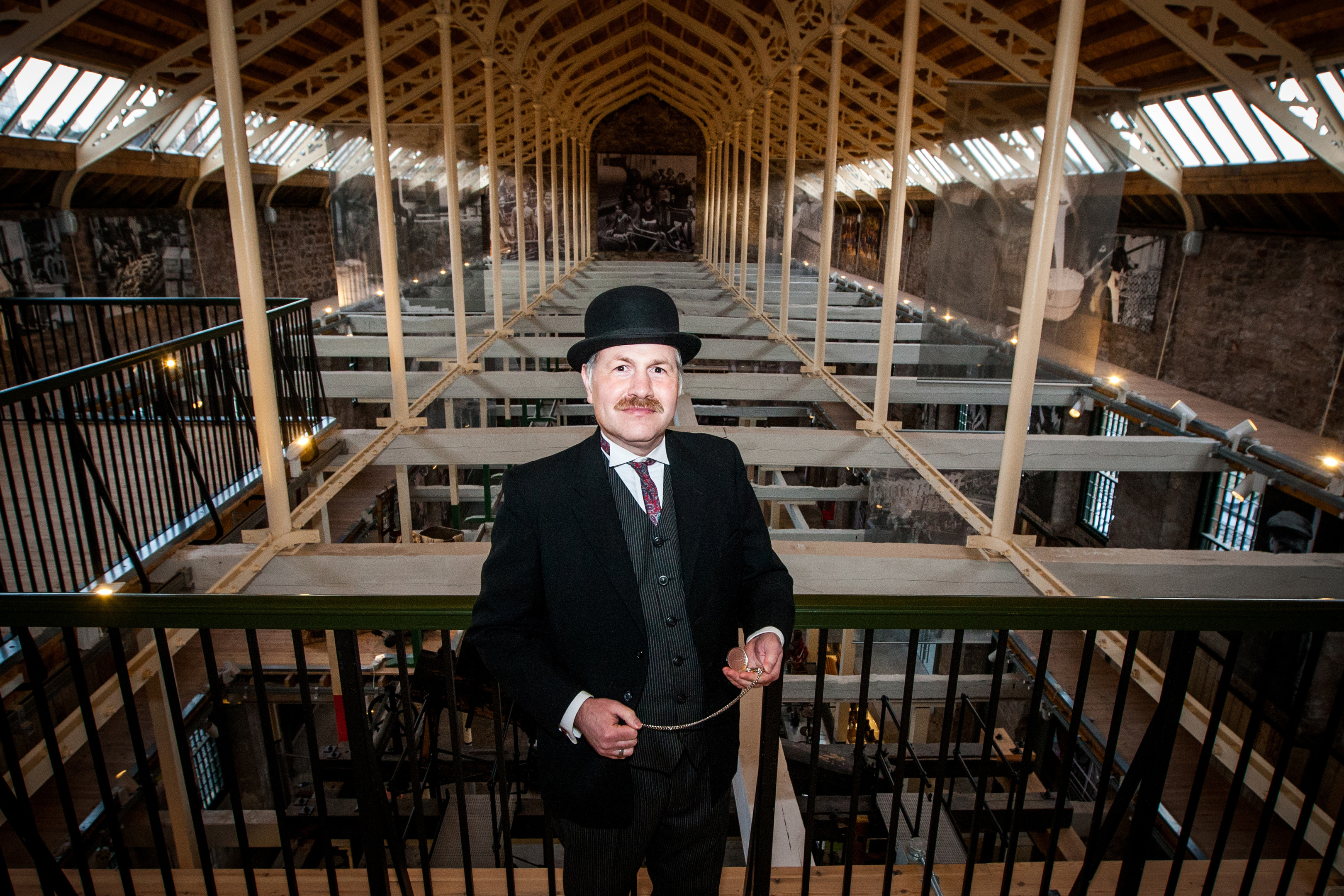 Volunteer guide Richard Irvine, in period dress as works manager, in the High Mill.