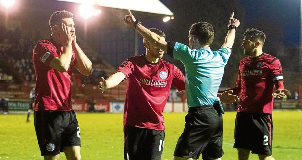 Brechin players protest the decision to award St Mirren a penalty.