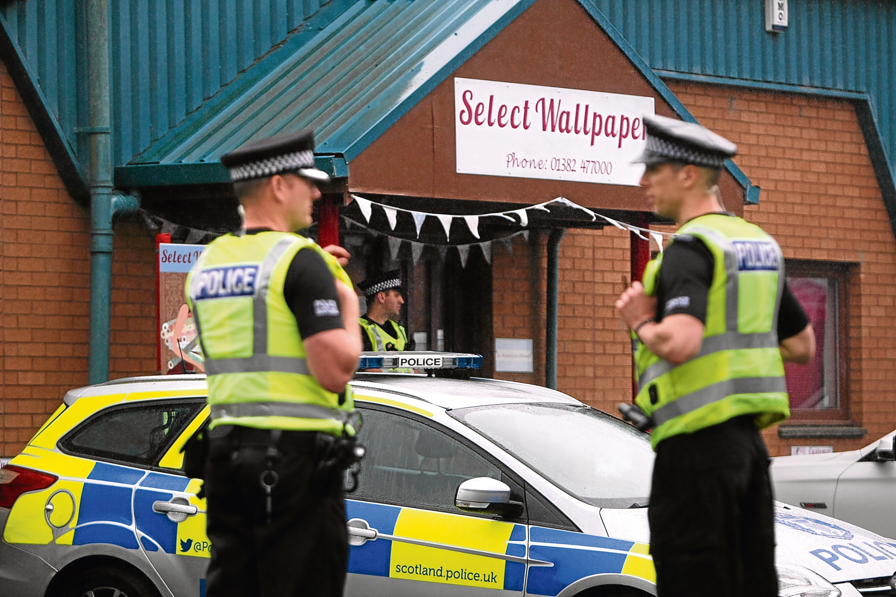 Police officers and vehicles in West Pitkerro Industrial estate on Wednesday, August 2.
