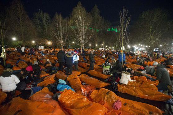 People taking part in Sleep in the Park in Princes Street Gardens.