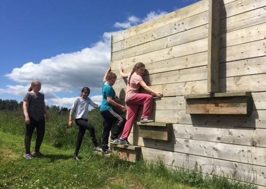 Dens Road Primary school pupils tackle an assault course.