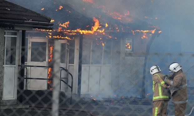 Firefighters get set to tackle the blaze at Cairneyhill Primary School.